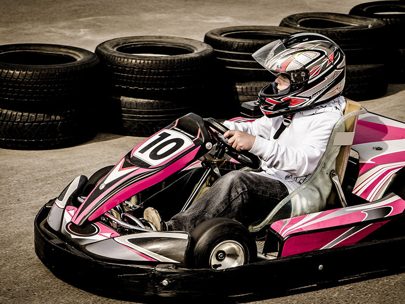 Image of boy riding a go kart at Turtle Back Ridge